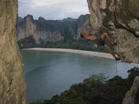 A Climber Negotiates an Overhang on Railay Beach Photographic Print