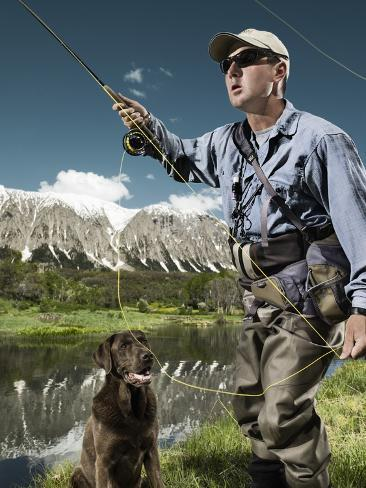 Man fly fishing with dog Photographic Print