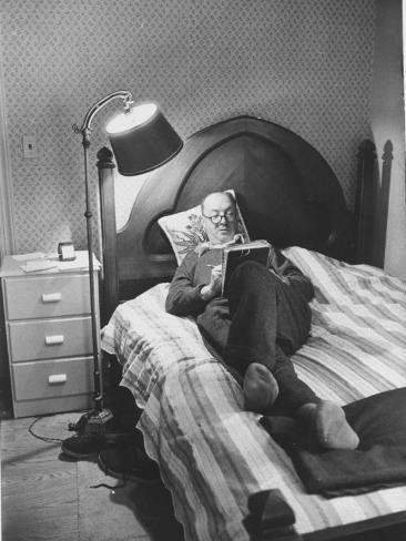 Author Vladimir Nabokov Writing While Lying on His Bed at Home Premium Photographic Print