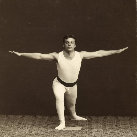 Portrait of a Young Gymnast as He Performs an Exercise Photographic Print
