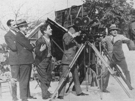 Charlie Chaplin Laughing During Shooting of Film Premium Photographic Print