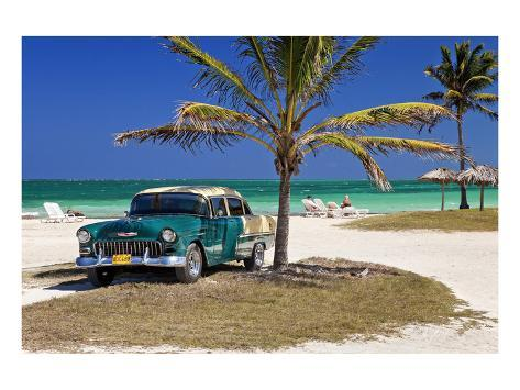 Chevrolet Classic Car Under A Palm Tree On The Beach Of Island Cayo Coco Cuba