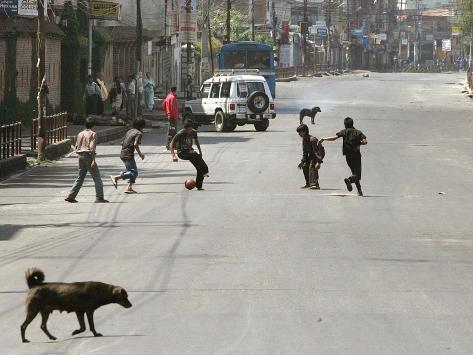 Children Play Soccer on a Deserted Street of Katmandu, Nepal Photographic Print