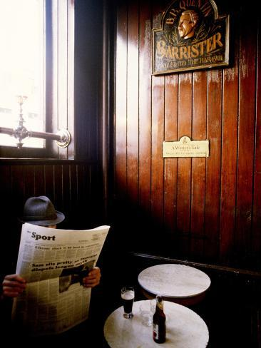 A Man with a Beer Reading a Newspaper in a Pub Photographic Print