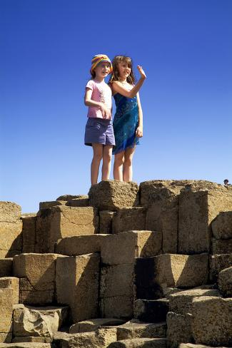Two Girls Playing at the Giant's Causeway in Northern Ireland Photographic Print
