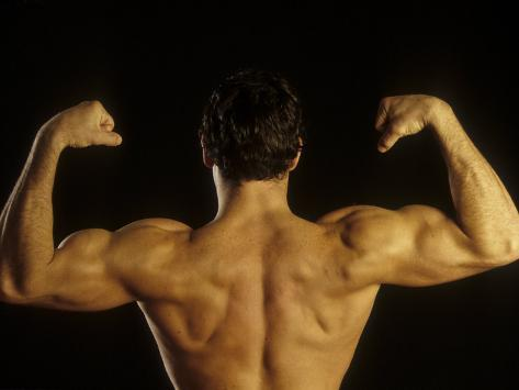 Young Adult Male Posing with Arms Flexed Photographic Print