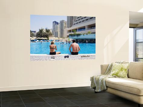 Couple Sitting by a Swimming Pool in the 40 Degree Heat Wall Mural