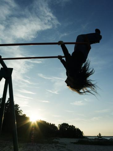 Girl Playing High on Swings at Sunset on Vosu Beach, Located in Lahemaa National Park Photographic Print
