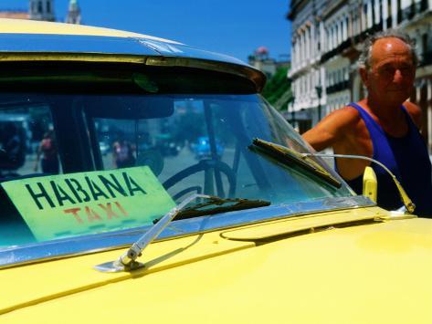 Man with 1950's Taxi, Havana, Cuba Photographic Print