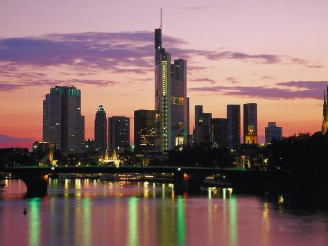 City Skyline of Frankfurt, Germany at Sunset with Reflections of Lights on Water Surface Photographic Print