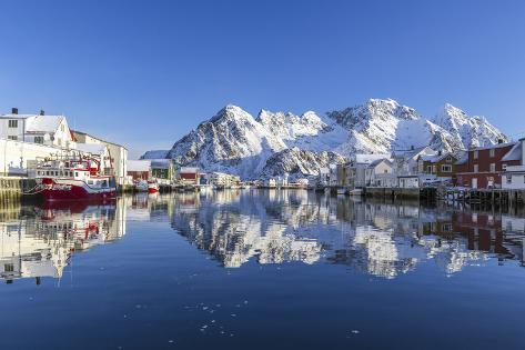 Houses and Mountains Reflected in the Waters of Henningsvaer Fjord. Lofoten Islands. Norway. Europe Valokuvavedos