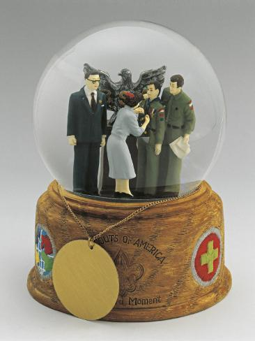 Close-Up of a Figurine of a Woman Giving Award to Figurines of Scouts in a Snow Globe Stretched Canvas Print