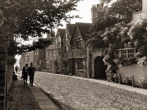 Couple Walking Down a Quiet Cobbled Road in Rye Sussex Photographic Print