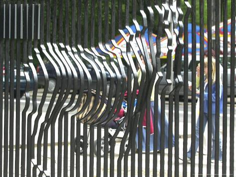 A zebra on the front gate of the 75 year old zoo in warsaw poland a zebra on the front gate of the 75 year old zoo in warsaw polandjune 24 2003 gumiabroncs Gallery