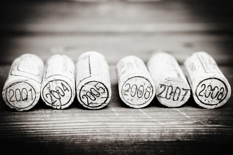 Dated Wine Bottle Corks On The Wooden Background Taidevedos