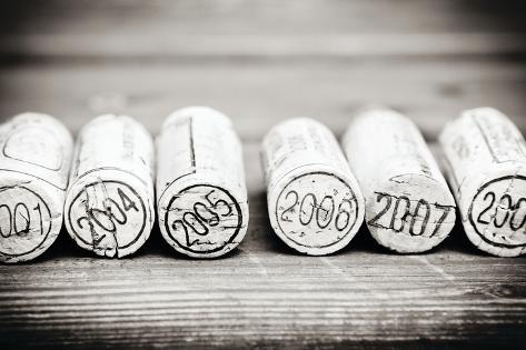 Dated Wine Bottle Corks On The Wooden Background Muovikyltit