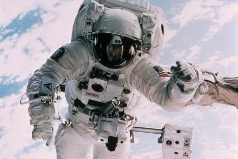 Astronaut Walking in Space Wall Mural