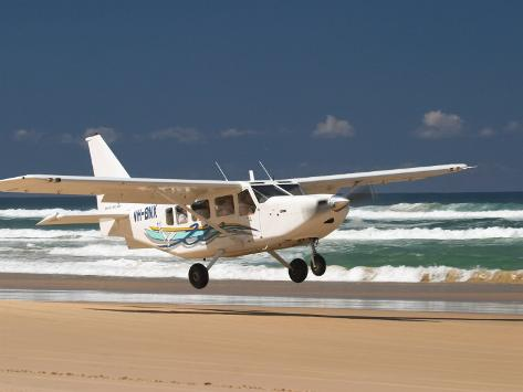 Plane About to Land on Seventy Five Mile Beach, Queensland, Australia Photographic Print