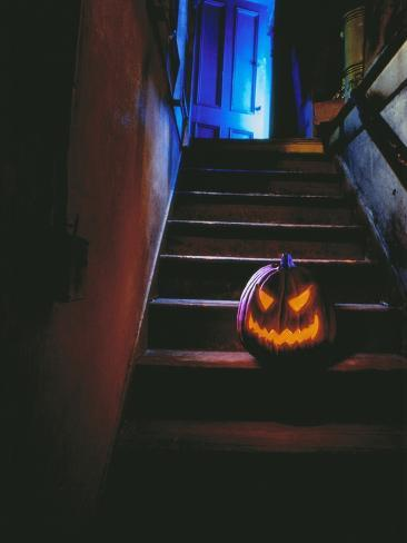 Halloween Pumpkin Sitting on Staircase Stretched Canvas Print