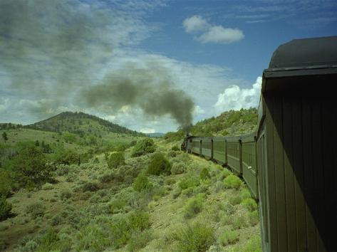 A Train is Seen Approaching Osier, Colorado, August 7, 2005 Photographic Print