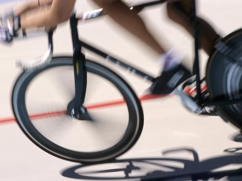 Detail of Blurred Action of Cyclist Competing on the Velodrome Photographic Print
