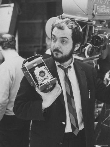Film Director Stanley Kubrick Holding Polaroid Camera During Filming of