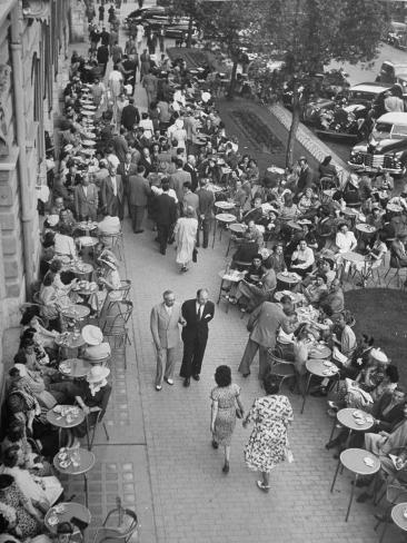 People Dining at Outside Cafe Next to the Hotel Excelsior Photographic Print