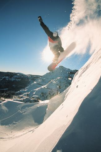 Snowboarding off a Cliff off Piste on a Sunny Day in Donner Pass, California, USA Photographic Print