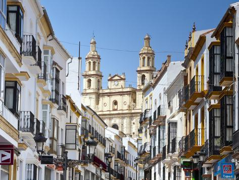 The Parish of Our Lady of the Incarnation Framed by Typical Architecture, Olvera, Cadiz Province, A Photographic Print