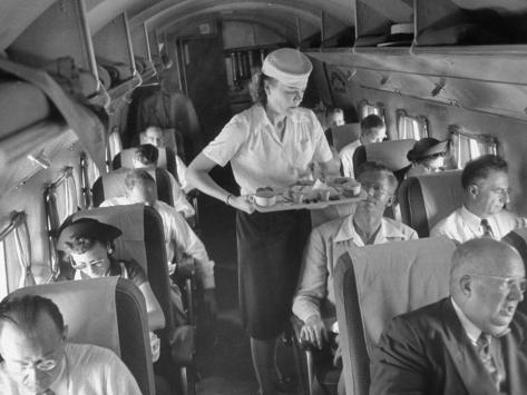 Eastern Airline Travelers Receiving a Mid-Flight Meal from a Female Steward Photographic Print