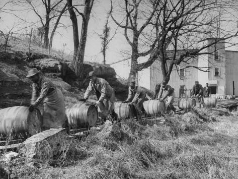Barrels Being Rolled on Wooden Rails at Jack Daniels Distillery Photographic Print