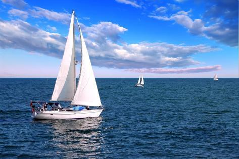 Sailboat Sailing in the Morning with Blue Cloudy Sky Photographic Print