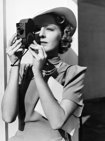 Portrait of a Young Woman Taking a Picture with a Camera Photographic Print