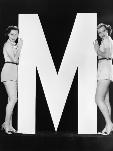 Two Women Posing with Huge Letter M Photographic Print