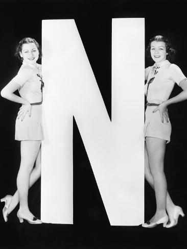 Two Women with Huge Letter N Photographic Print