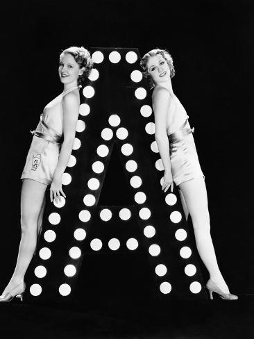 Two Young Women Posing with the Letter A Photographic Print