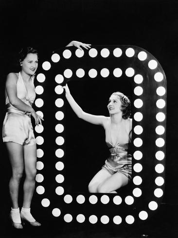 Two Young Women Posing with the Letter O Photographic Print