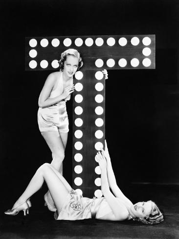 Two Young Women Posing with the Letter T Photographic Print
