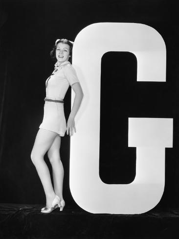 Woman Posing with Huge Letter G Photographic Print