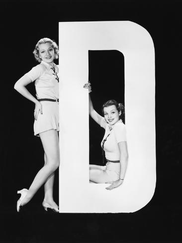 Women Posing with Huge Letter D Photographic Print