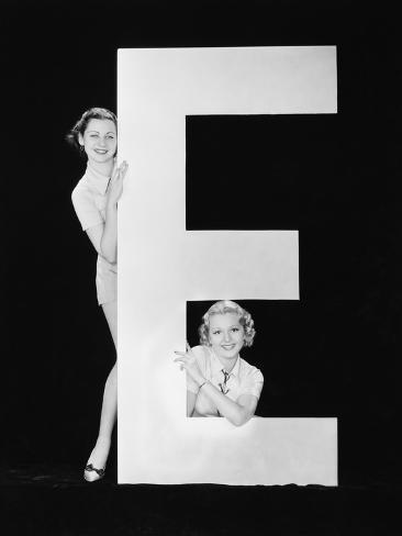 Women Posing with Huge Letter E Photographic Print