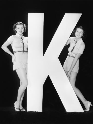Women Posing with Huge Letter K Photographic Print