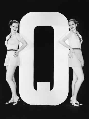 Women Posing with Huge Letter Q Photographic Print