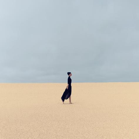 Stylish Girl in Black Clothes Walking in the Desert Photographic Print