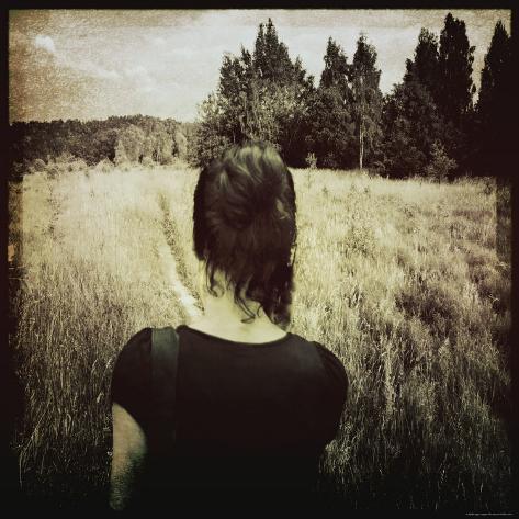 Woman Following Trail in Field Fotoprint