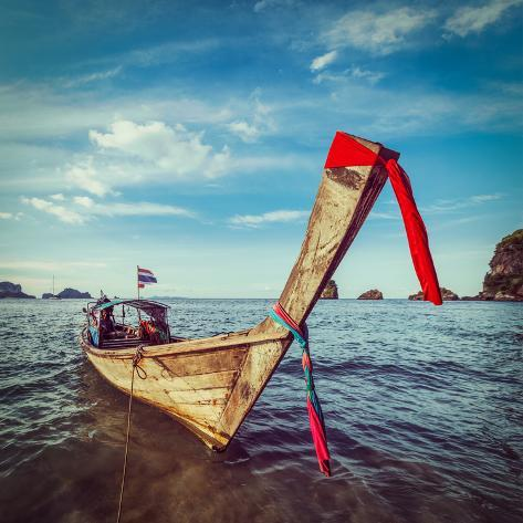 Vintage Retro Hipster Style Travel Image of Thai Long Tail Boat on Sunset, Krabi, Thailand Valokuvavedos