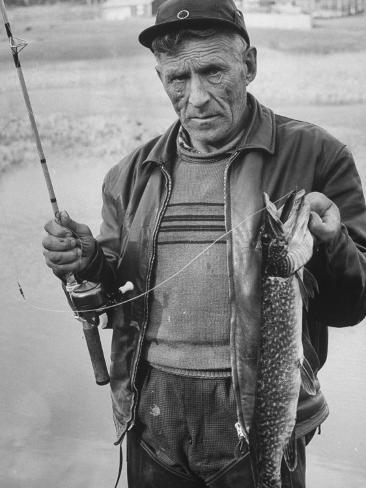 Fisherman Lauri Rapala, Who Handmakes Fishing Lures, with a Fish He Caught Photographic Print