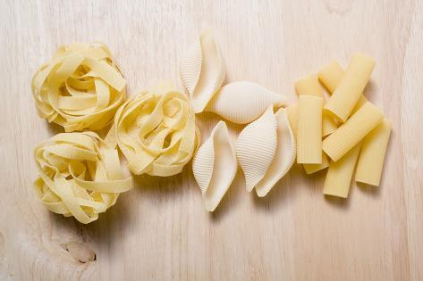 Assorted Pasta on Wooden Background Photographic Print