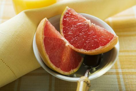 Grapefruit Wedges in a Bowl Photographic Print