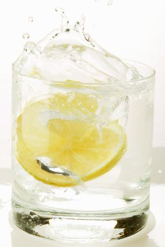 Slice of Lemon Falling into a Drink Photographic Print